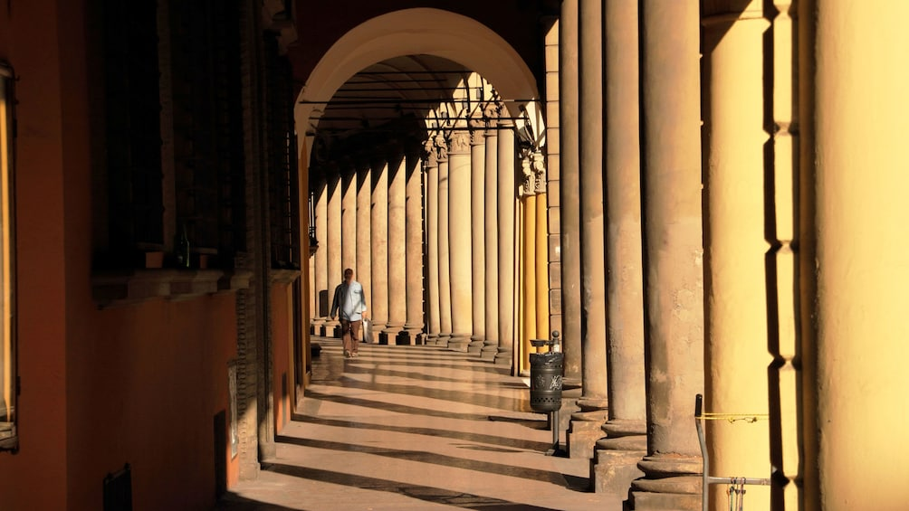 Man walks through hall of Bologna