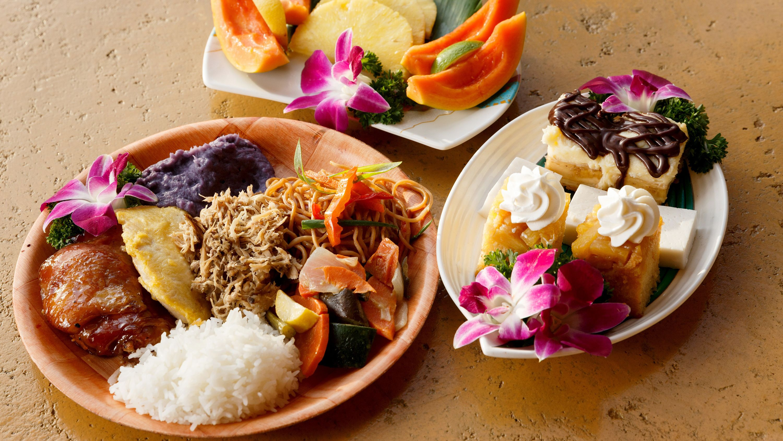 Plates of Polynesian food at a luau on Oahu