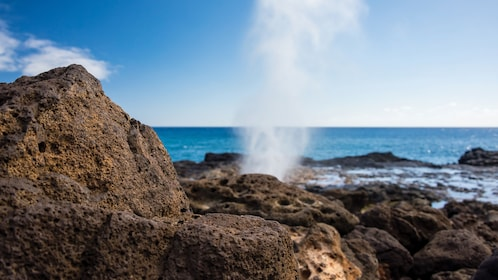Water shooting out of a blowhole on the coast of Oahu