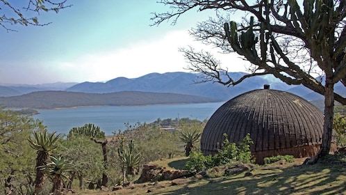 View of Zulu kraal overlooking lake in Shakaland