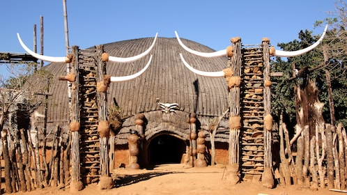 View of large building in Zulu kraal in Shakaland