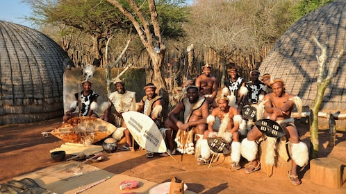 Group of men in traditional Zulu clothing in Shakaland