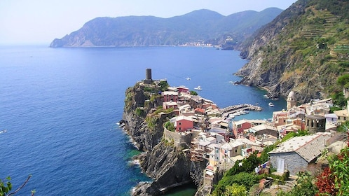 View out onto the water of Vernazza on cliffside in Italy