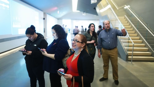 Group goes through exhibit at Edward M. Kennedy Institute in Boston