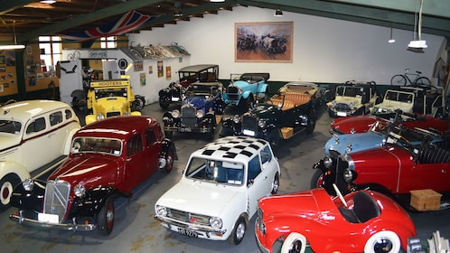 Garage of Hooters Vintage and Classic Vehicle Hire full of cars in Napier