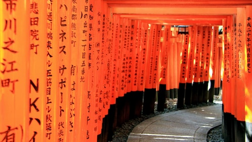Writing on the pillars that line the pathway of Fushimi Inari in Kyoto