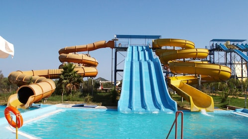 Multiple tall water slides at water park in Ionian Islands