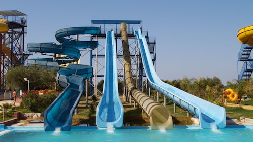 Four tall water slides at water park on Ionian Islands