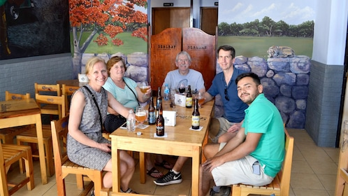 Guests enjoying drinks on the Cantinas Tour in Merida, Yucatan, Mexico