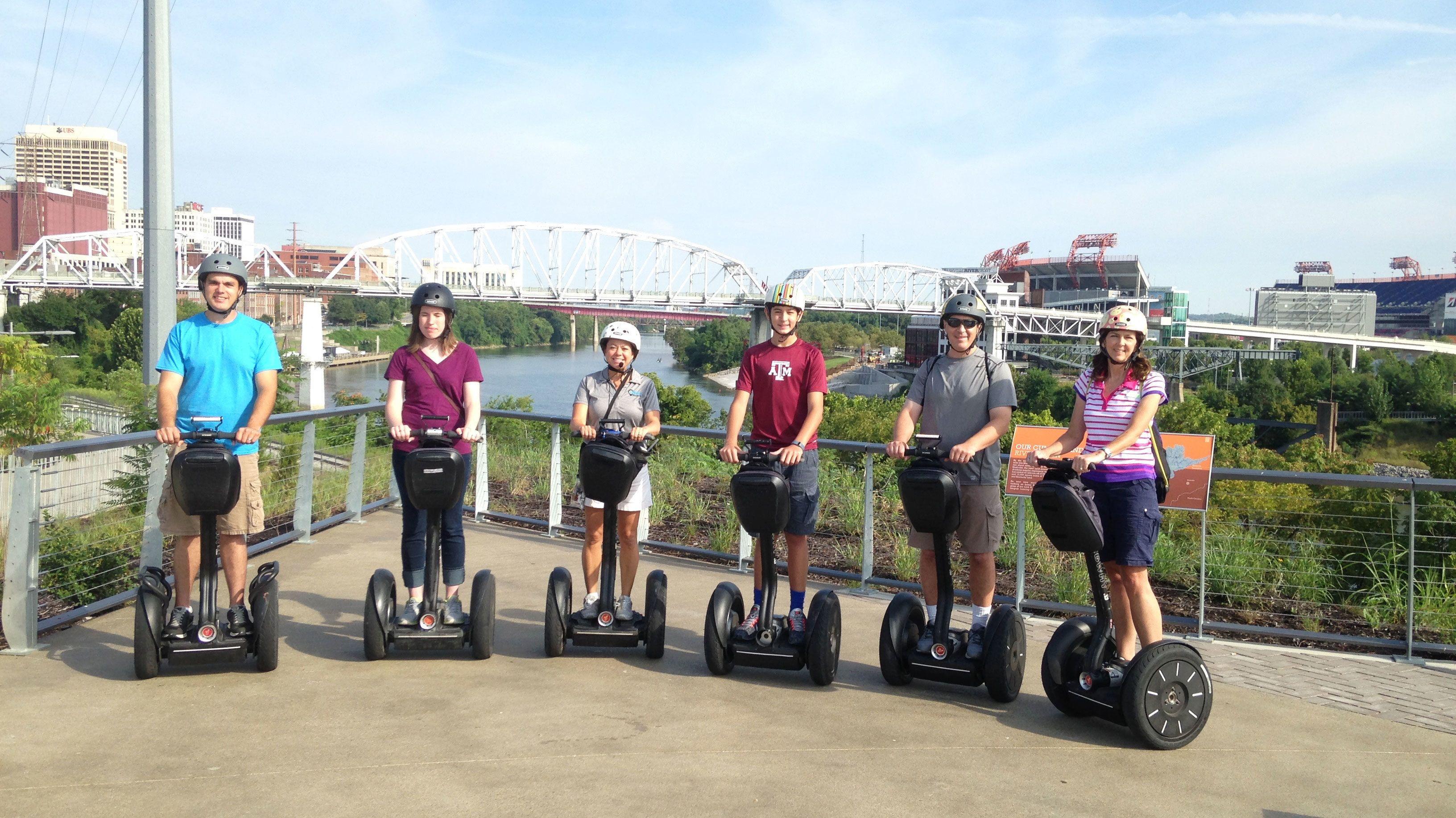 Segway group in front of bridge in Nashville