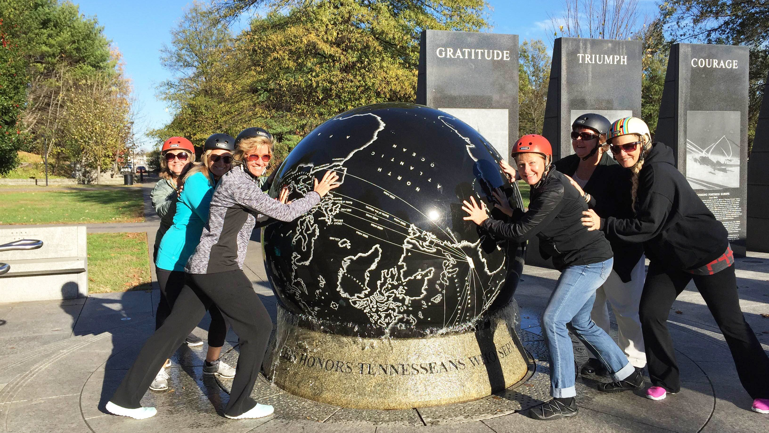 Segway group touch large globe in park in Nashville