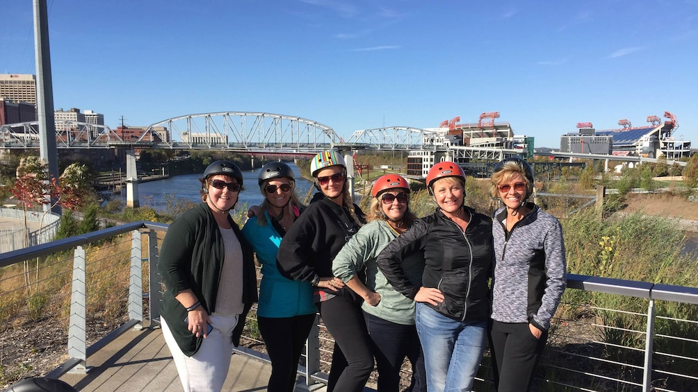 Group poses for photo with segways nearby on tour in Nashville