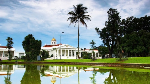 View of Bogor Palace from across pond in Indonesia