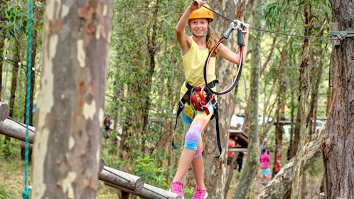 Girl climbing through adventure park in Adelaide