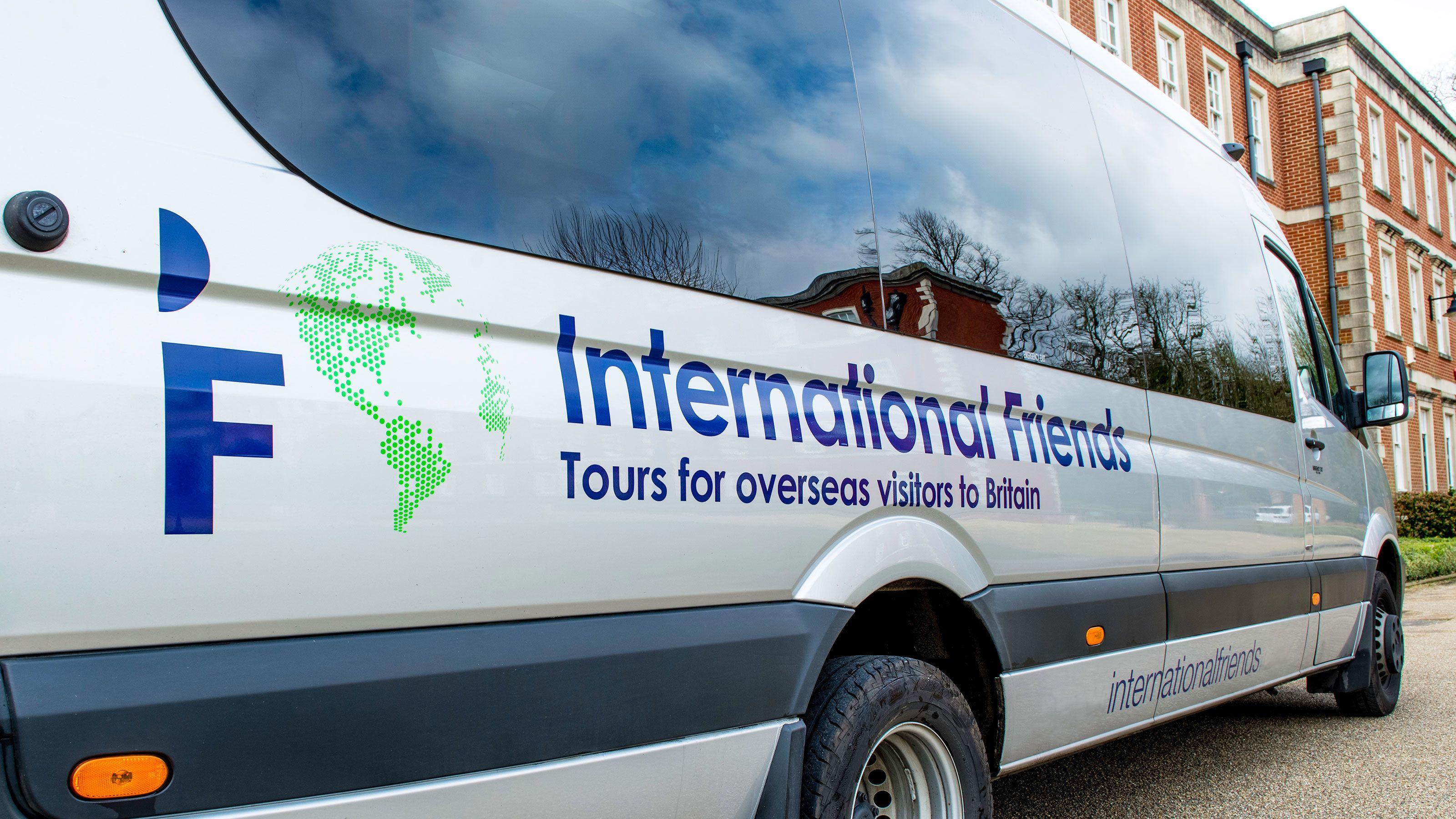 Tour van parked on street during tour in Shilton