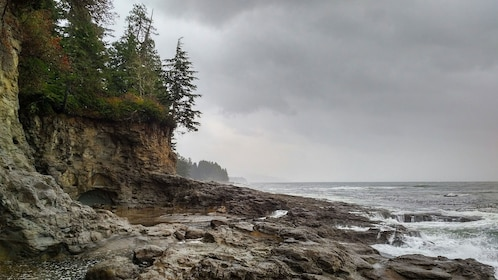 Rocky beach with cliffs as storm approaches in Port Renfrew