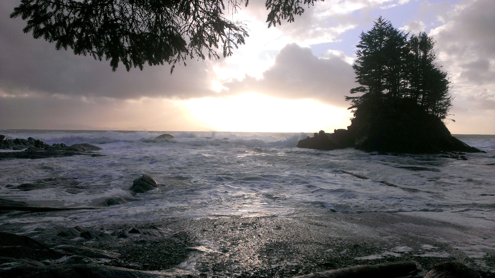 Show item 3 of 5. Tide comes in as the sun sets on Port Renfrew