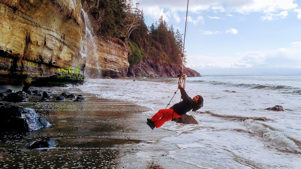 Show item 1 of 5. Woman swings on rope at Port Renfrew