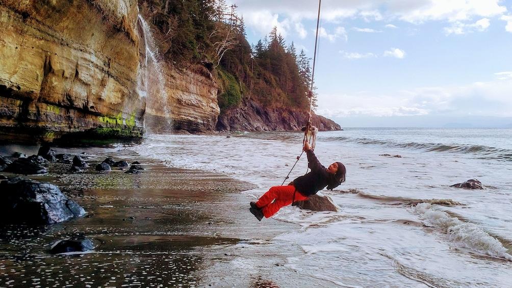 Woman swings on rope at Port Renfrew
