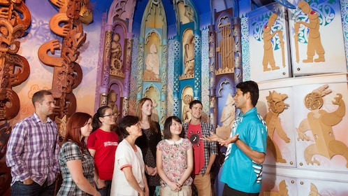 Tour guide talks with group at Te Papa museum in Wellington