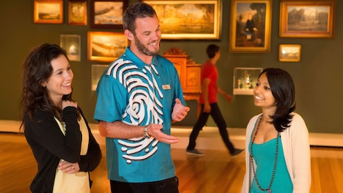 Tour Guide laughs with tourists at Te Papa Museum in Wellington