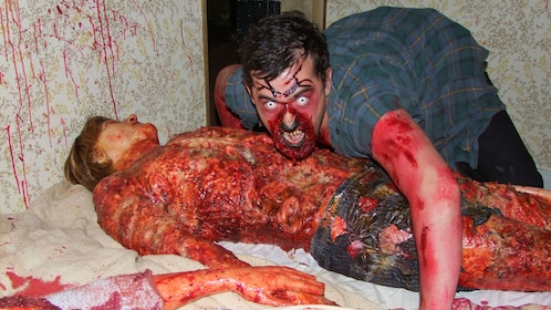 Actor with zombie makeup in Spookers Haunted Attraction Theme Park in Auckland