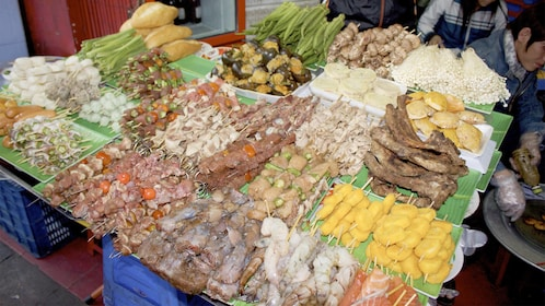 Meat skewers and vegetables sold at the street markets in Hue, Vietnam