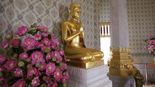 Golden statue in temple in Bangkok