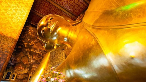 Large golden statue in temple in Bangkok