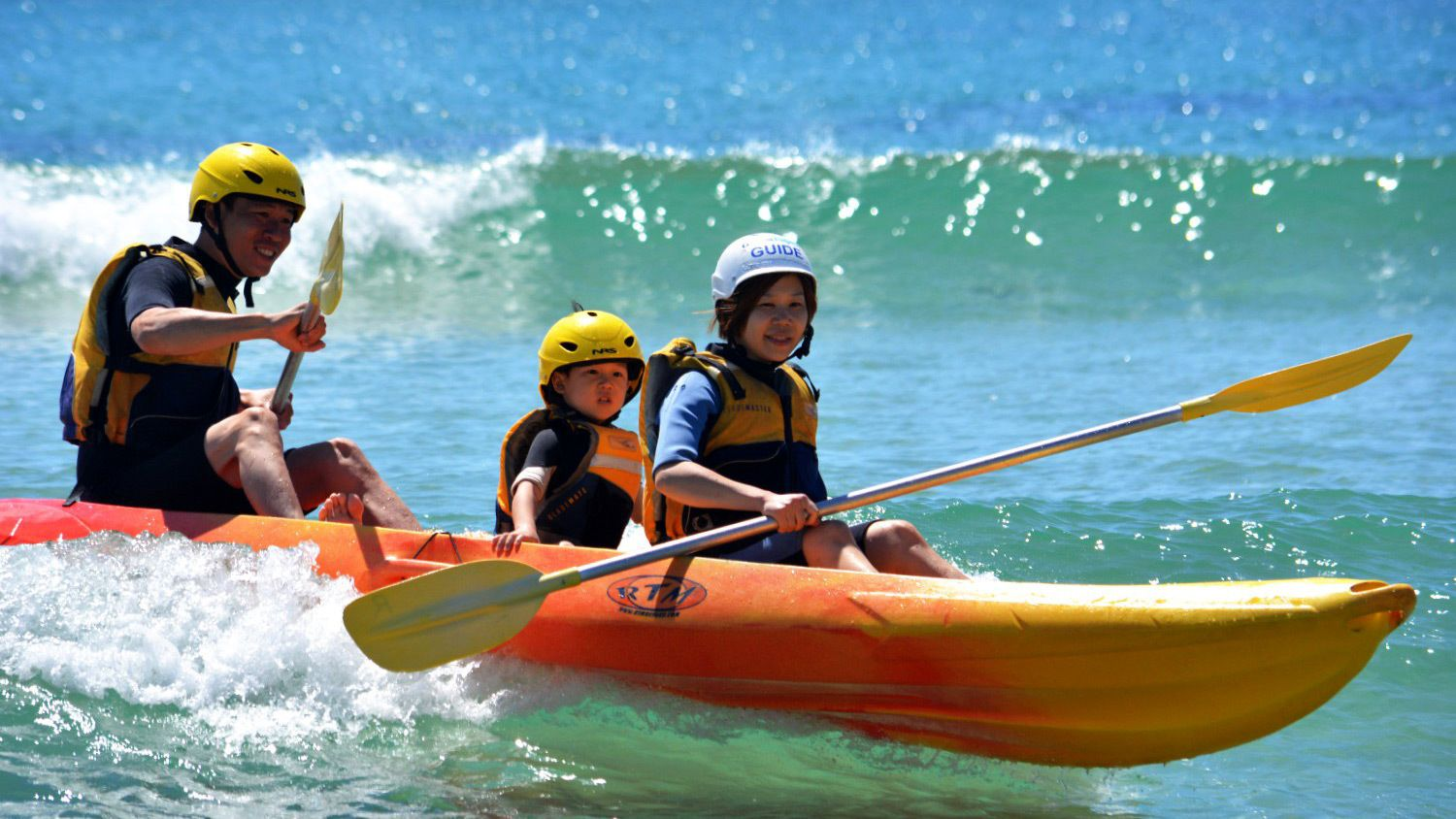 Family on a kayak in Byron Bay