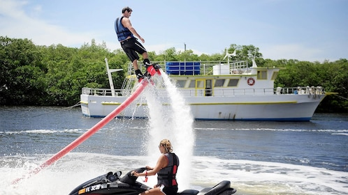 View of a man flyboarding in Miami