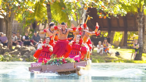 Dancers aboard a boat at the Polynesian Cultural Center luau in Oahu