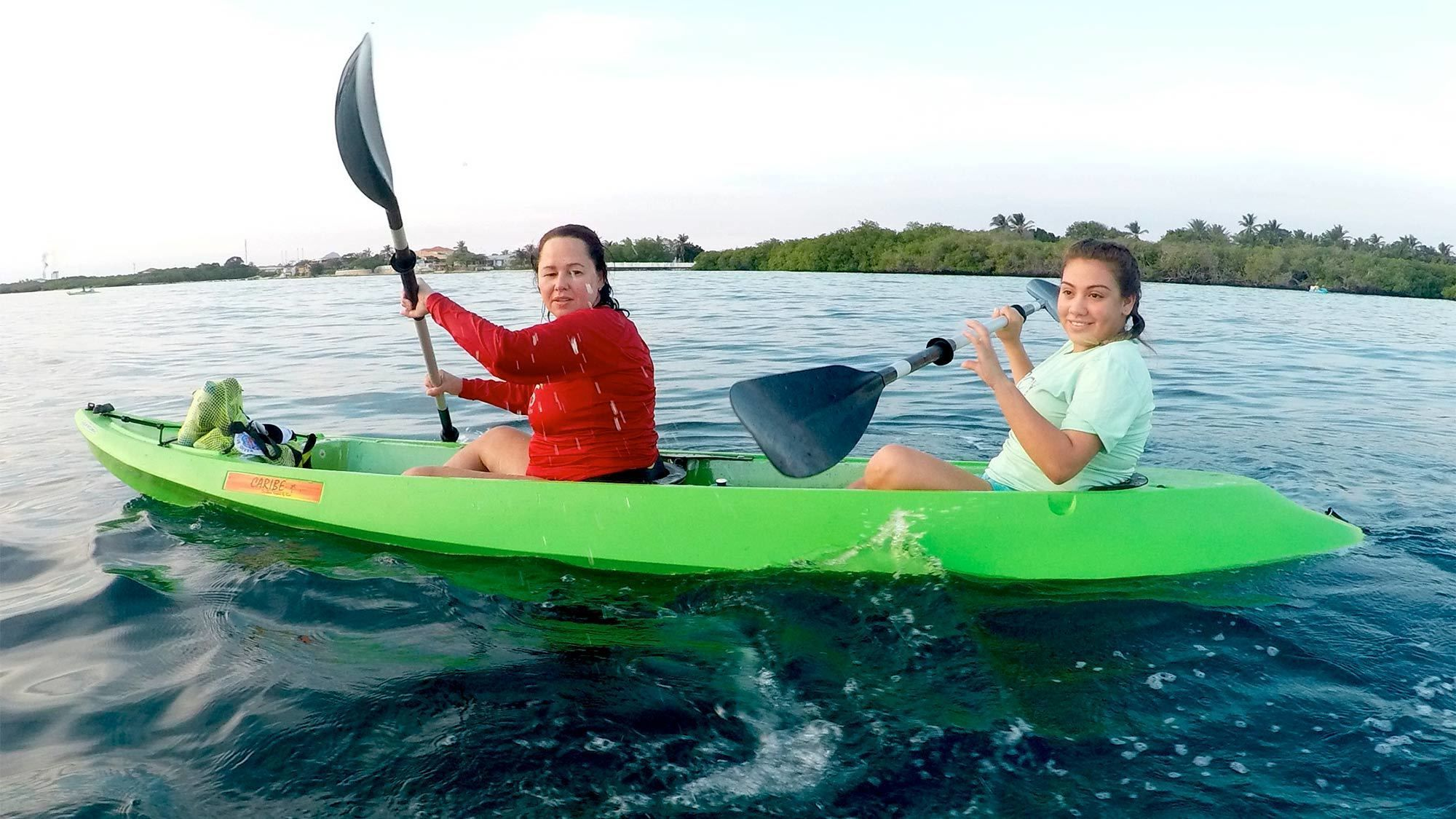 Two ladies having fun on the Glass Bottom Kayak Tour Savaneta