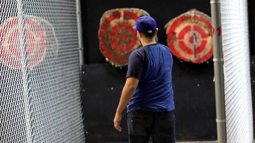 Man throwing an axe at a target in Las Vegas