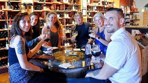 Group enjoying drinks in wine store in Huntington Beach