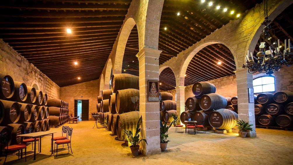 Show item 3 of 10. Large barrels of wine at a vineyard in Seville