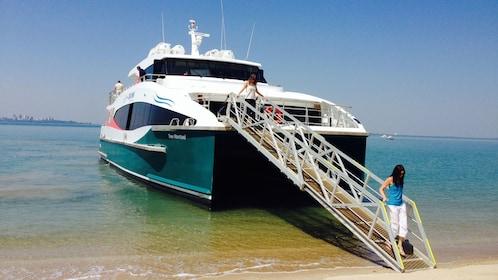 Passengers walking off cruise boat in Darwin