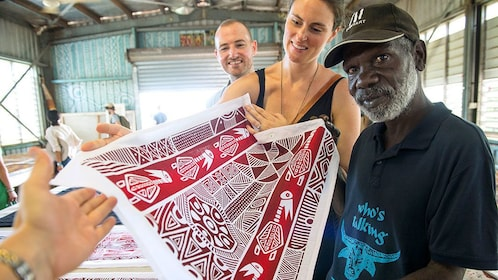 Tourist couple and creator with artwork in Darwin