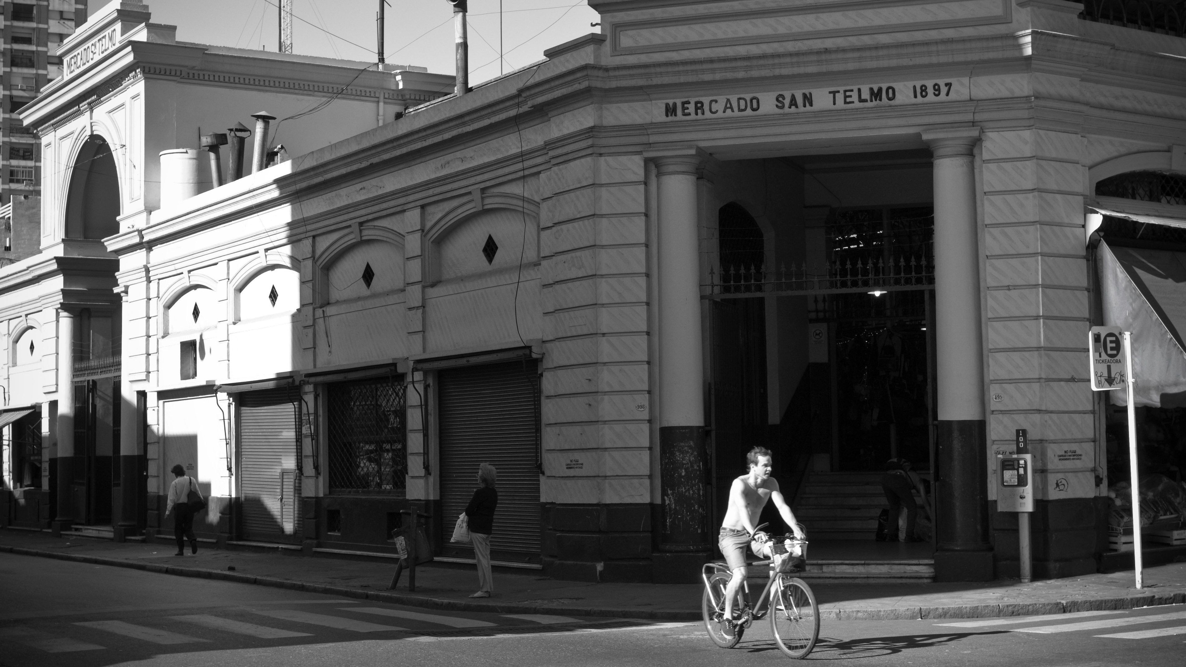 Man riding bicycle down street of Buenos Aires