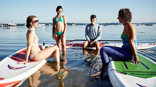 Group enjoying the sun and having fun on the Stand-Up Paddleboard activity in Portland, ME