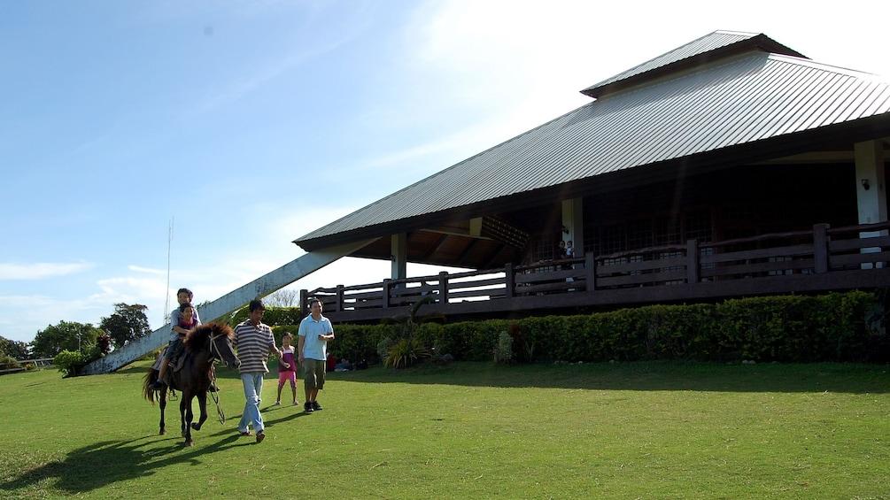 Show item 3 of 5. Horseback riding at Mitra's Ranch in Cebu