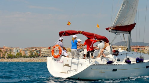 People on a Catamaran in the waters off of Barcelona