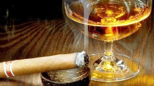 Cigar next to a snifter of Rum