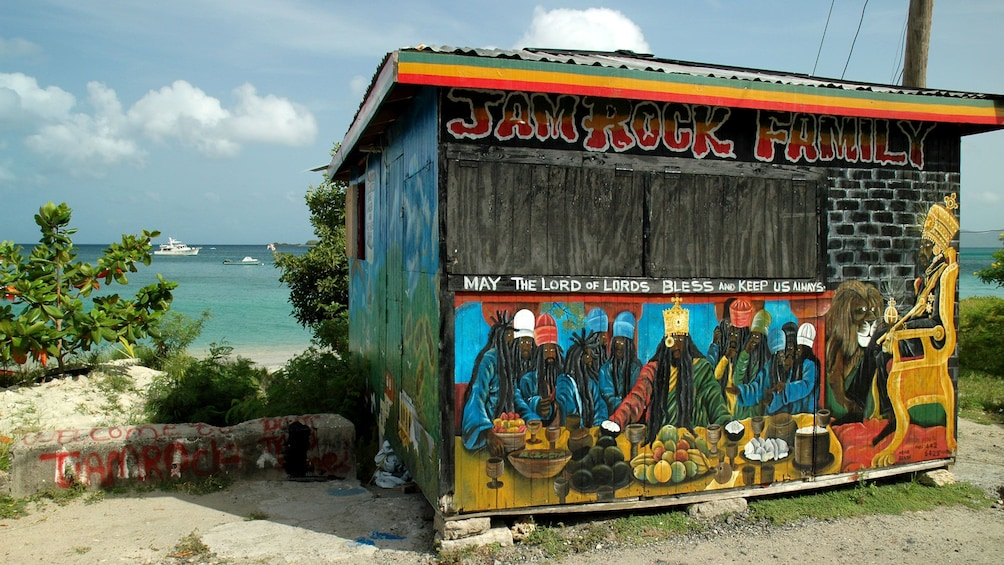 Show item 5 of 5. Colorful shack by the beach in Carriacou