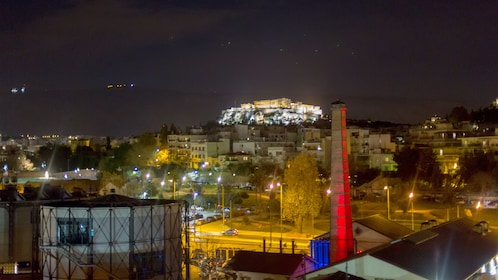 View of the Acropolis at night from a platform over Athens
