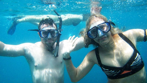 Snorkelers posing for photo in Koh Tao