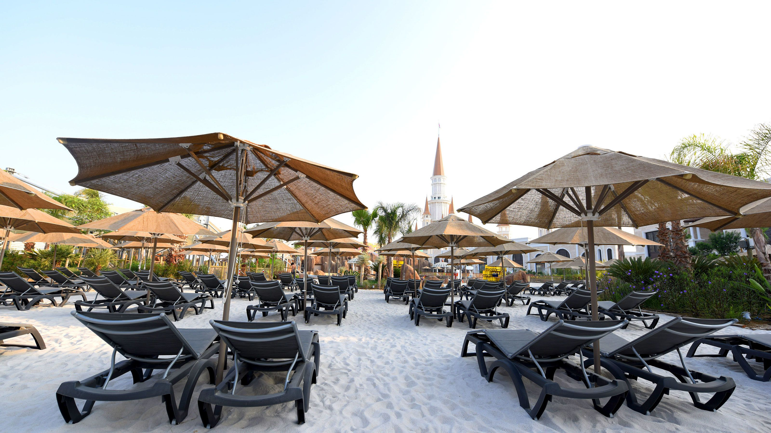 Lounge chairs on beach at Land of Legends theme park in Antalya