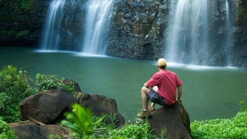 Man watching waterfall in Kauai