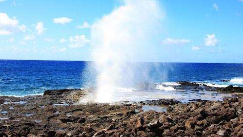 natural geyser on shore of Kauai
