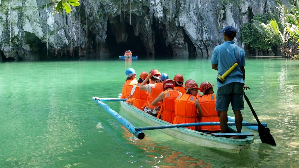 Boating group near sea caves in Cebu